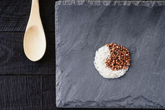 Symbol of yin and yang and wooden spoon Stock Photography