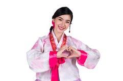Symbole coréen d'exposition de dame de l'amour à la main et robe originale de la Corée Image stock