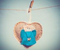Symbole d'amour de forme de coeur avec l'ange Photo libre de droits