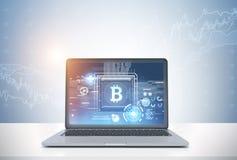 Symbole de bitcoin d'ordinateur portable et graphique, bureau Images libres de droits