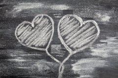 Symbole de coeur d'amour de craie dessus Images stock