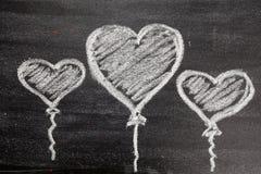 Symbole de coeur d'amour de craie dessus Photographie stock libre de droits