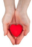 Symbole de coeur dans des mains Photos libres de droits