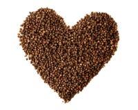 Symbole de coeur de grains de poivre de poivre noir Photos stock