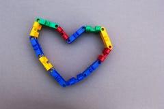 Symbole de coeur du concepteur sur un fond gris, concept photo libre de droits