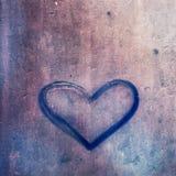 Symbole de coeur sur le fond grunge en métal Photos libres de droits