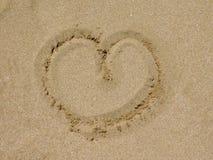 Symbole de coeur sur le sable Photographie stock