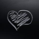 Symbole de coeur sur le tableau noir Photo stock