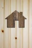 Symbole de la maison du bois foncé Photographie stock