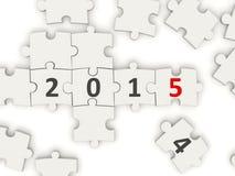 Symbole de la nouvelle année 2015 sur le puzzle Photographie stock libre de droits