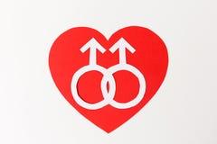 Symbole de Mars sur le coeur rouge au-dessus du fond blanc Image stock