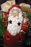 Symbole de Noël avec un cadeau sur le fond Photos stock