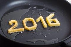Symbole de nouvelle année frit sur une casserole Photographie stock libre de droits