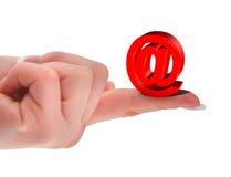 Symbole de rouge @ sur le doigt Image stock