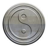 Symbole de Yin Yang découpé dans la pierre Photo libre de droits