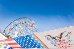 Symbole der USA-Flagge und des Riesenrads Lizenzfreie Stockfotografie