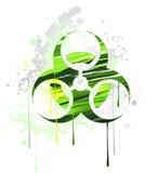 Symbole du danger biologique dessiné avec la peinture Photographie stock libre de droits