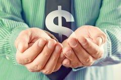 Symbole du dollar dans des mains Photos libres de droits