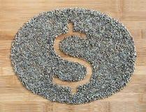 Symbole du dollar fait de graines de chanvre Images stock