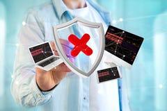 Symbole entaillé de bouclier entouré par des dispositifs et réseau montré photo libre de droits