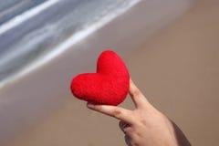 Symbole et sable d'amour Photo stock