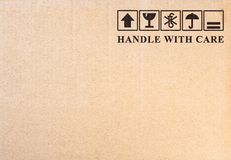 Symbole fragile sur le fond de carton Photo stock