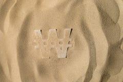Symbole gagné sous le sable photographie stock libre de droits