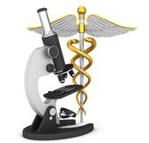 Symbole médical et microscope de caducée Photos stock