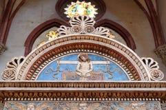 Symbole pasja w lunette, San Petronio bazylika w Bologna fotografia royalty free
