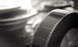 Symbole passé de film de temps, objets évocateurs de bobine de film de 35 millimètres Photo libre de droits