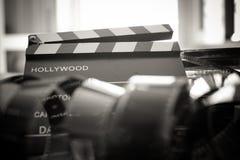 Symbole passé de film de temps, objets évocateurs de bobine de film de 35 millimètres Images libres de droits