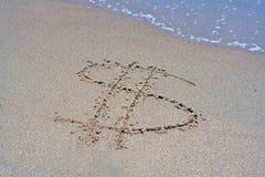 Symbole pour le dollar ($) écrit en sable Photo libre de droits