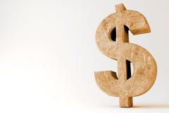 Symbole rocheux du dollar Photographie stock