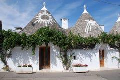Symbolen op Trulli Daken, Puglia stock foto