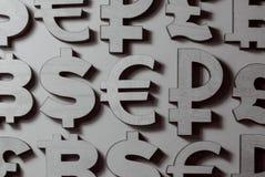 Symbolen van geld en munten royalty-vrije stock afbeeldingen