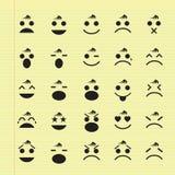 Symboler av smileyframsidor Arkivfoton
