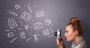 Symboler för fotografi för fotografflickaskytte Royaltyfri Foto