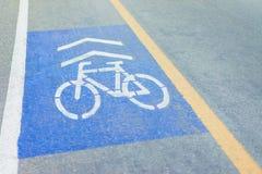 Symboler på cykeln på vägen Fotografering för Bildbyråer