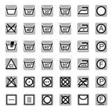 Symboler tvagning och att bleka, torka som stryker, kemtvätt Arkivfoto