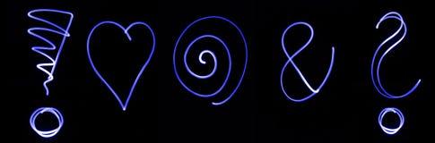 Symboles au néon bleus Photos stock
