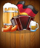 Symboles d'Oktoberfest sur un fond en bois Image stock