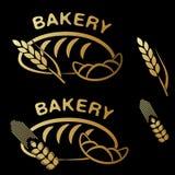 Symboles de boutique de boulangerie Icône simple d'or de grain de croissant, de pain et de transitoire sur le fond noir Image libre de droits
