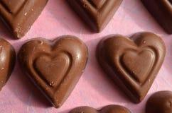 Symboles de jour de valentines de chocolat de forme de coeur de l'amour Photographie stock libre de droits