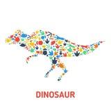 Symboles des dinosaures et des empreintes de pas de dinosaure Photographie stock libre de droits