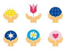 Symboles des mains retenant différentes choses Images libres de droits