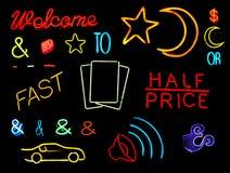 Symboles et mots au néon Image stock