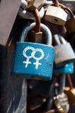 Symboles femelles sur une serrure Photographie stock libre de droits