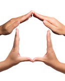 Symbolhem som göras en gest med händer arkivbild