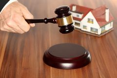 Symbolic auction with house model. And gavel royalty free stock photo
