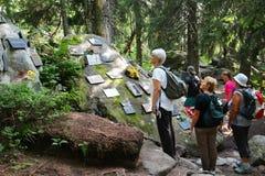 Symbolic cemetery in Hight Tatras, Slovakia. POPRADSKE PLESO, SLOVAKIA - AUGUST 27, 2015: People visit the symbolic cemetery in High Tatras, a memorial to people Stock Photo
